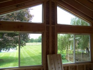 New vinyl slider and trapezoid windows in sun porch