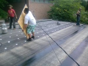 Polybond roof being installed on a home